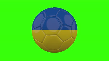 futball labda : Ukraine flag on a ball rotates on a transparent green background, 4k prores footage with alpha transparency, loop Stock mozgókép