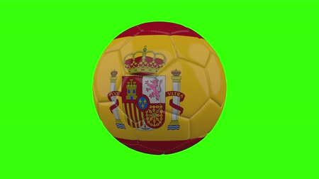 futball labda : Spain flag on a ball rotates on a transparent green background, 4k prores footage with alpha transparency, loop Stock mozgókép
