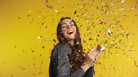 Happy woman throwing confetti enjoying party. Celebration and event concept. Slow motion Стоковые видеозаписи