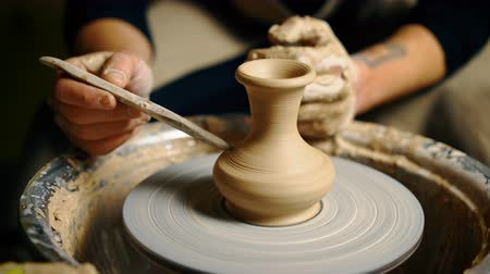 Potter modeling ceramic pot from clay on a potters wheel Stok Video