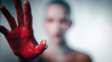 bloody hands : Mystery girl stretch her bloody arms forward to camera Stock Footage