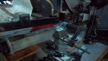 bandsaw : slowmotion - footage of metalworking equipment, bandsaw machine, closeup metal processing Stock Footage