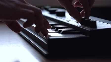 zeneszerző : Man playing on musical analog keyboard. Close up. Slowmotion.