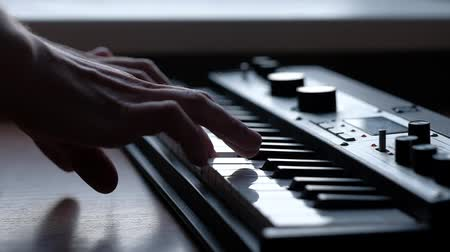 zeneszerző : Musician playing on musical keyboard. Slowmotion