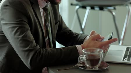 lawyer : Close-up businessman using smartphone on coffee break. Technology concept. Stock Footage