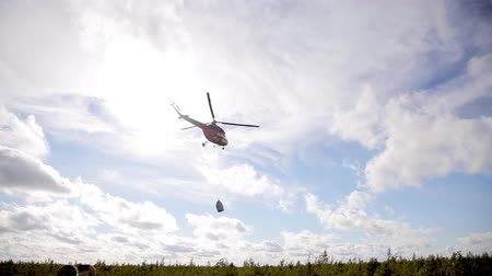 heliport : Military helicopter with garbage cargo in the sky. Conservation Stock Footage