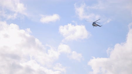 heliport : Military blue helicopter flies in the clouds