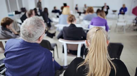 workshop : People looks as the speaker tells the interesting speech at business conference Stock Footage