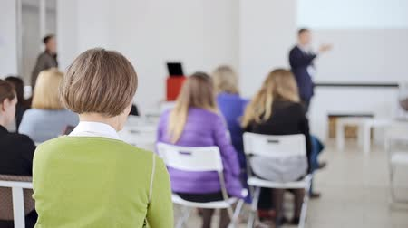 conference centre : People looks as the speaker tells the interesting speech at business seminar or presentation Stock Footage