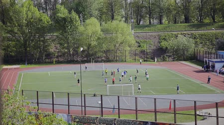 pojedynek : Group of the kids are playing football for exercise in the sunshine day