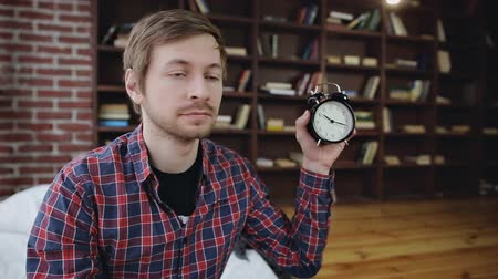 minute : Young man student shows the time on the clock