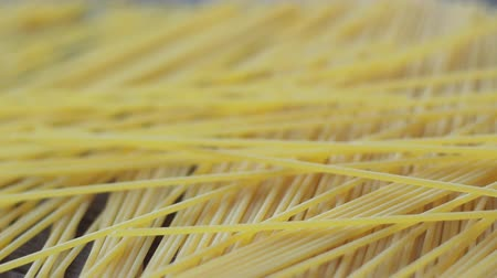 makaróni : Close up of raw uncooked spaghetti falling in slow motion, italian pasta Stock mozgókép