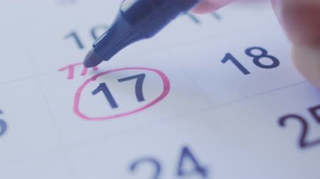 refund : Hand Circling Tax Date on a Calender with Pen Stock Footage