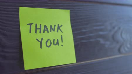 sayesinde : Sticker with text Thank you on it, isolated on wooden background