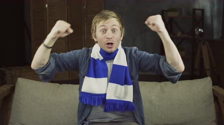 kutluyor : Portrait of happy football fan with scarf screaming for the support of his team
