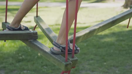 veselí : Staggering steps for children in the public playground with kids leg