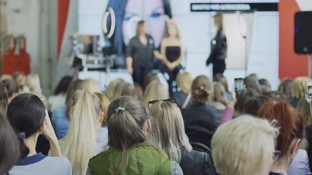 irodaház : Audience Listening To Speaker At Cosmetics Make Up Conference