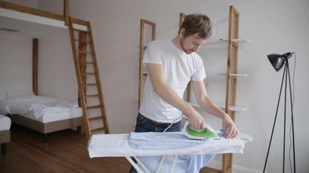 гладильный : Young Happy Man Ironing Clothes On Ironing Board At Home
