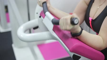biceps curls : Close up of senior woman doing exercise in a fitness center. She is working exercises to strengthen her biceps