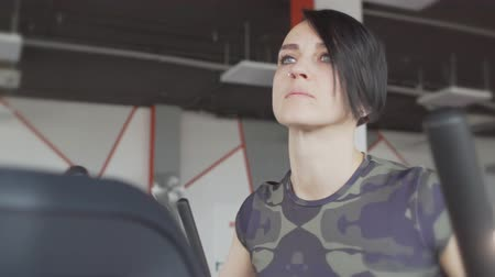 treadmill : Close up of young short hair style woman running on a treadmill in a modern gym