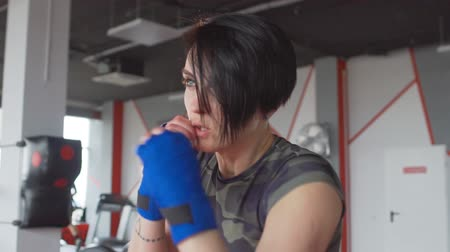 feminist : Brunette female boxer at training inside a boxing ring Stock Footage