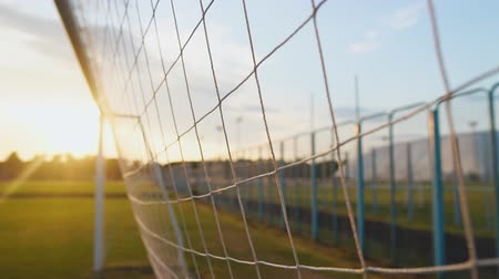 Close up of soccer or football net at sunset