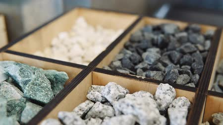 landscaping rocks : Bright and colorful minerals for sale in a designer garden store Stock Footage