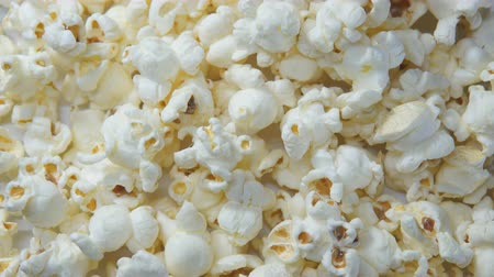 塩辛い : Top view of salted popcorn rotating close-up. Popcorn background.