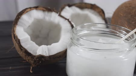 vlasy : Coconuts and organic coconut oil in a glass jar. Dolly slider