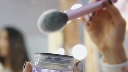 Cosmetic make-up brush spreading blush powder in slow motion Dostupné videozáznamy