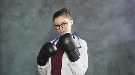Portrait of doctor woman with boxing gloves