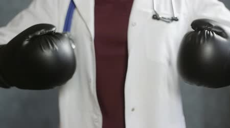 Close up of doctor woman with boxing gloves