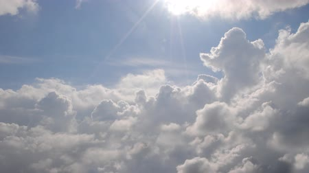 Cloudscape with bright sun. Стоковые видеозаписи