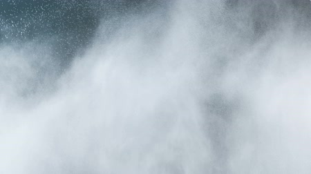 fizik : Water mist, steam cloud in slow-motion against black background.