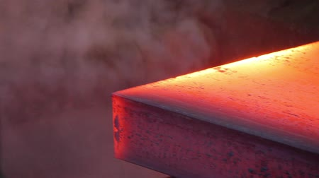 Hot steel ingots on conveyor. Foundry casting process, black metallurgy manufacture. Wideo