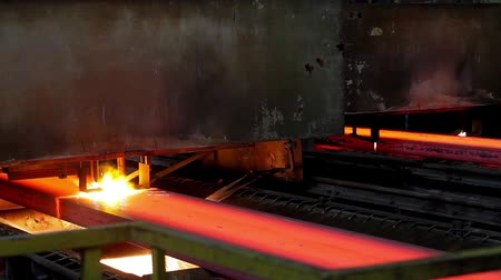 Hot steel ingots cutting on conveyor. Foundry casting process, black metallurgy manufacture.