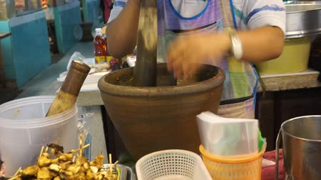 kari : Making Thai chilli fresh paste in a mortar with pestle