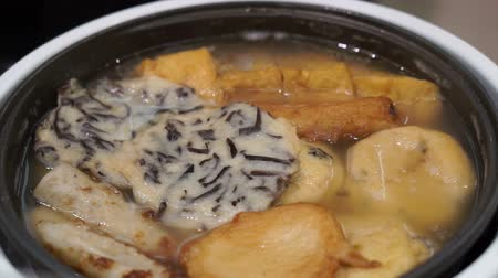 oden : Variety kind of Japanese food short footage Beef on rice, tuna, sashimi, raw egg on top, oden, soup, fish ball, dessert, takoyaki, shrimp tempura, udon and chicken on screw Stock Footage