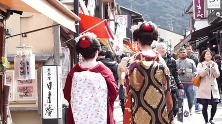 japan : Kyoto, Japan - March 2015: Beautiful Japanese Geisha with beautiful kimono walking along the street in Kyoto Japan
