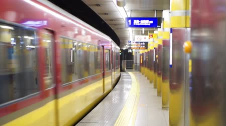 ticket machine : Osaka, Japan - MARCH 2015: Train running through subway stations platform with no people standing