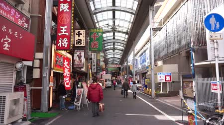 billboards : Osaka, Janpan - March 2015: Pedestrians walking around the Dotonbori shopping district in Osaka, Japan Stock Footage