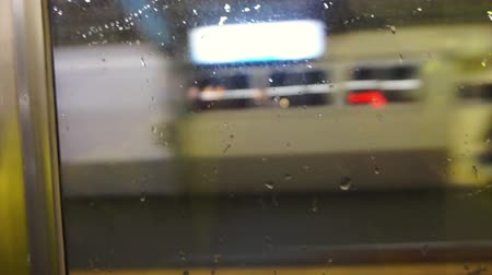 rainy : Tourist traveller point of view. City light from POV in rainy day through train window at night