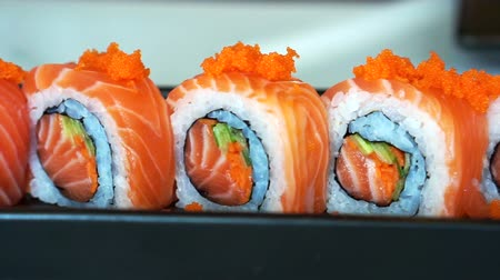 roll : Video of salmon maki roll. Japanese sushi cuisine with fresh raw fish