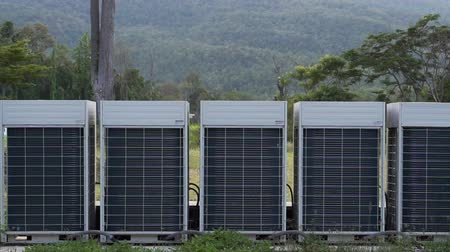 from air : Huge air conditioner outdoor units outside with mountain background