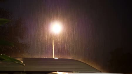 множество : Video of Heavy raining at night on car parking lot