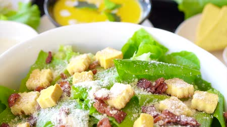 césar : Beautiful colourful caesar salad with dressing croutons and parmesan cheese together with yellow pumpkin soup. healthy meal
