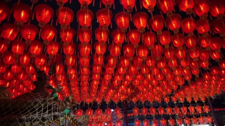 to celebrate : HD video of Thousand of Chinese red lanterns. Illuminate lamps to celebrate Chinese New Year. Beautiful night scene of temple in Taiwan