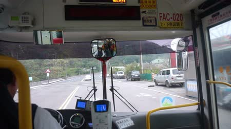 inside bus : Yehliu, Taiwan, ROC- Feb 22, 2016: POV Inside view of the Taiwanese Bus. Driver driving to destination Stock Footage