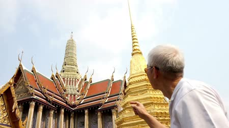 kaew : Asian senior man visiting Wat Phra Kaew, Temple of the Emerald Buddha Landmark of Bangkok,Thailand