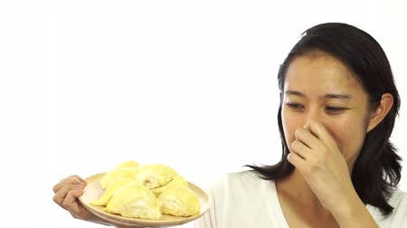 kötü : Asian girl can not stand the smell of stinky durian. Smelly fruit of tropical area